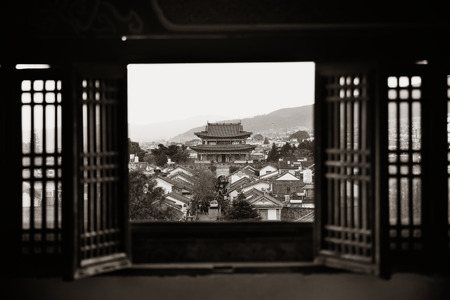 old windows: Dali old town rooftop viewed from Wuhua House. Yunnan, China. Stock Photo