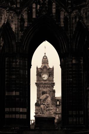 scott monument: Balmoral Hotel bell tower viewed through Scott Monument in Edinburgh Stock Photo