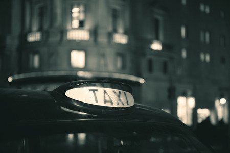 taxi cab: Vintage taxi in street in London at night.