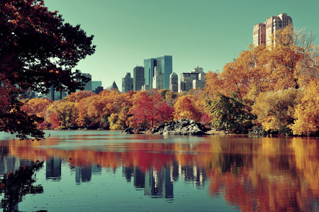 Central Park Autumn and buildings reflection in midtown Manhattan New York City Stock Photo
