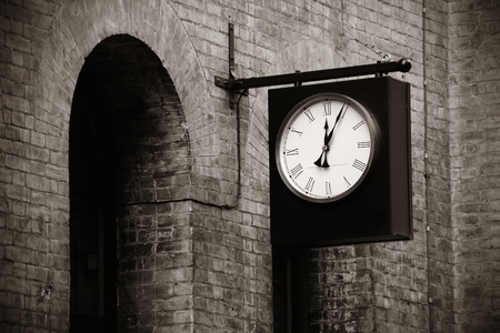 arches: Urban historical architecture with vintage clock in street in London. Stock Photo