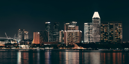 Singapore skyline at night with urban buildings Stock Photo