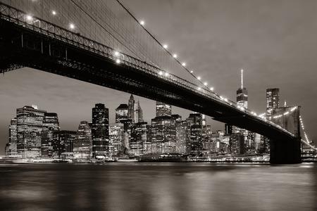 city night: Manhattan Downtown urban view with Brooklyn bridge at night Stock Photo