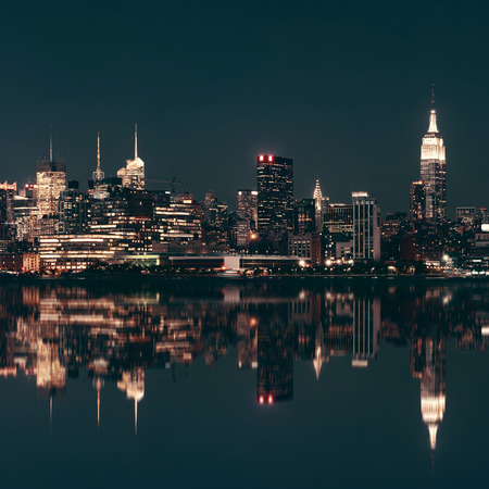city by night: Midtown Manhattan skyline at dusk panorama over Hudson River with reflections