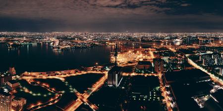 city night: Osaka urban city sea port at night rooftop view. Japan.