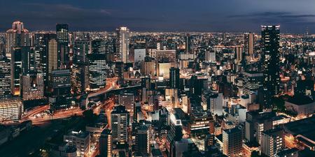 city night: Osaka urban city at night panorama rooftop view. Japan.