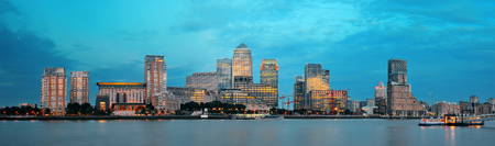 wharf: Canary Wharf business district in London at sunset.