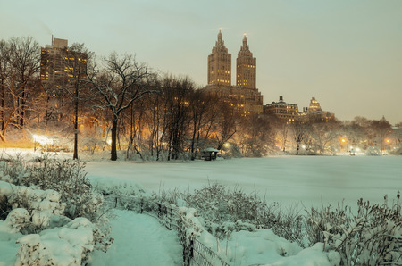 winter park: Central Park winter at night with skyscrapers in midtown Manhattan New York City Stock Photo