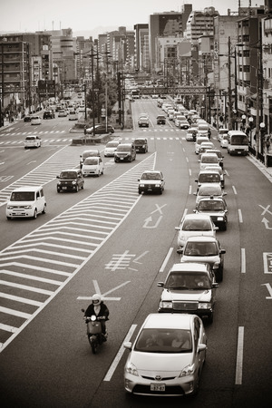 former years: KYOTO, JAPAN - MAY 18: Traffic jam on road on May 18, 2013 in Kyoto. Former imperial capital of Japan for more than one thousand years, it has the name of City of Ten Thousand Shrines.