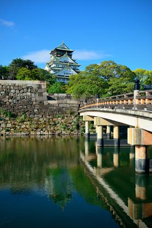 historical landmark: Osaka Castle with bridge as the famous historical landmark of the city. Japan.