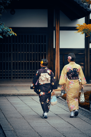 japanese kimono: Japanese woman in traditional costume in shrine with historical building in Kyoto, Japan. Stock Photo