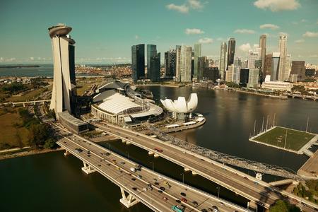 singapore building: Singapore skyline with urban buildings over water