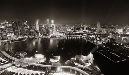marina bay: Singapore Marina Bay rooftop view with urban skyscrapers at night. Editorial