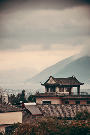 historical buildings: Dali Old Town with misty mountain and historical buildings in Yunnan, China.
