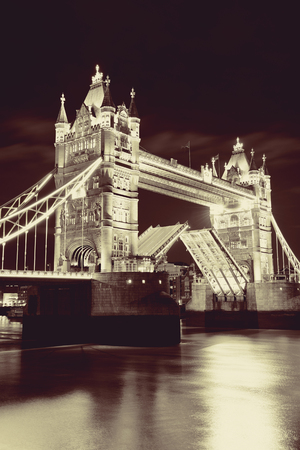 thames: Tower Bridge over Thames River at night in London