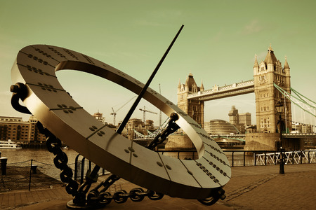thames: Tower Bridge and sundial over Thames River in London. Stock Photo