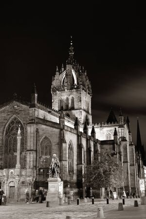 giles: EDINBURGH, UK - OCT 8: St Giles Cathedral and street view on October 8, 2013 in Edinburgh. As the capital city of Scotland, it is the largest financial centre after London in the UK.
