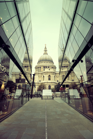 st   pauls cathedral: LONDON, UK - SEP 27: St Pauls Cathedral and glass reflections on September 27, 2013 in London, UK. London is the worlds most visited city and the capital of UK.