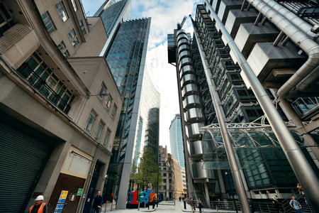 conducted: LONDON, UK - SEP 27: Financial district office buildings in street on September 27, 2013 in London, UK. London is the worlds greatest foreign exchange market with major trade conducted in the district.