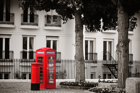 telephone booth: Red telephone booth and mail box in street in London as the famous icons.
