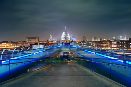 night skyline: Millennium Bridge and St Pauls Cathedral at night in London