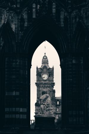 scott monument: Balmoral Hotel bell tower viewed through Scott Monument in Edinburgh Editorial