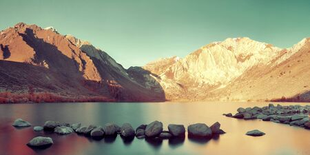 sierra nevada mountain range: Snow mountain and Convict Lake with reflections in Yosemite panorama.
