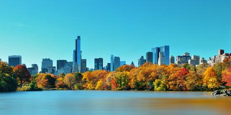 city park skyline: Central Park Autumn and midtown skyline over lake in Manhattan New York City Stock Photo