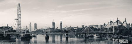 palace of westminster: Thames River panorama with London Eye and Westminster Palace in black and white in London. Stock Photo