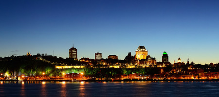 levis: Quebec City skyline panorama at dusk over river viewed from Levis.