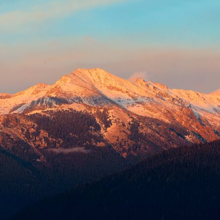 sunrise mountain: Kings Canyon mountain with snow and cloud at sunset