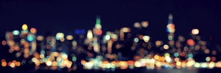 hudson: Midtown Manhattan skyline bokeh at dusk panorama over Hudson River