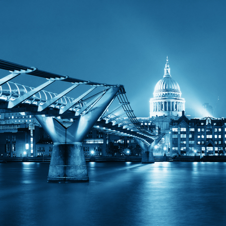london skyline: Millennium Bridge and St Pauls Cathedral at night in London