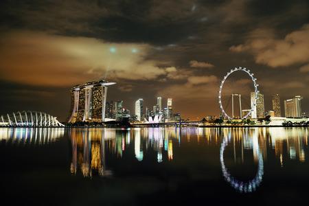 singapore skyline: Singapore skyline at night with urban buildings Editorial