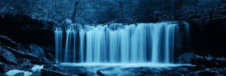 waterfall: Waterfalls in woods in black and white panorama.