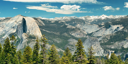 Yosemite mountain ridge with waterfall.