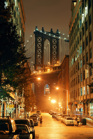 Manhattan Bridge viewed from street at night Stock Photo