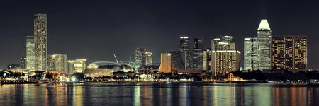 dark night: Singapore skyline at night with urban buildings Editorial