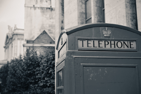 telephone booth: telephone booth in street with historical architecture in London.