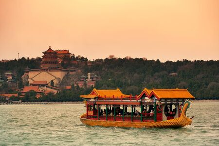 historical architecture: Summer Palace with historical architecture and boat in Beijing. Editorial
