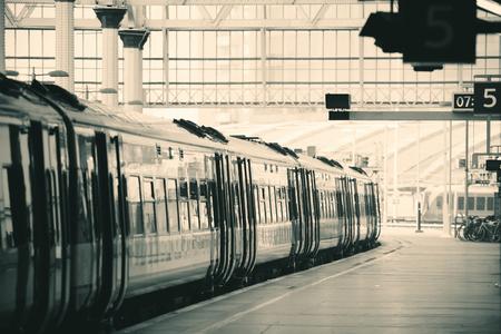 railway: Train on platform in station in London