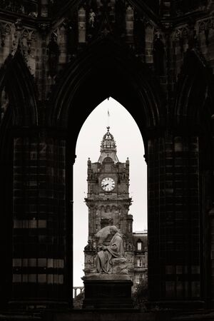 bell tower: Balmoral Hotel bell tower viewed through Scott Monument in Edinburgh Stock Photo
