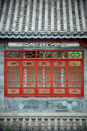 Local Bai style architecture roof and window in Dali old town. Yunnan, China. Imagens