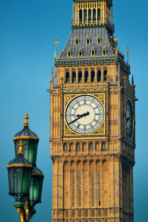 lamp post: Big Ben closeup in London with vintage lamp post. Stock Photo