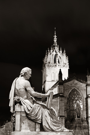 kirk: St Giles Cathedral with David Hume statue as the famous landmark of Edinburgh. United Kingdom.