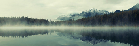 Lake Herbert panorama in a foggy morning with glaciers mountain and reflection in Banff National Park, Canada Stok Fotoğraf