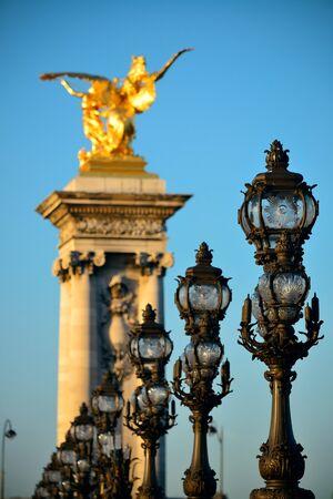 alexandre: Vintage lamp post on Alexandre III bridge in Paris, France.