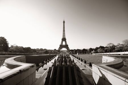 steel tower: Eiffel Tower with fountain pipe as the famous city landmark in Paris