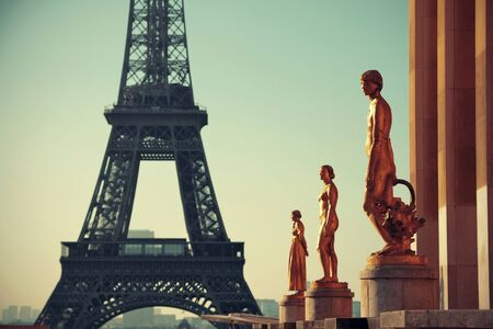 steel tower: Eiffel Tower with statue as the famous city landmark in Paris