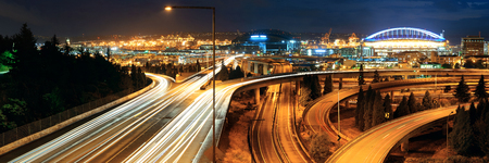 office buildings: Seattle at night with traffic light trails and highway Stock Photo